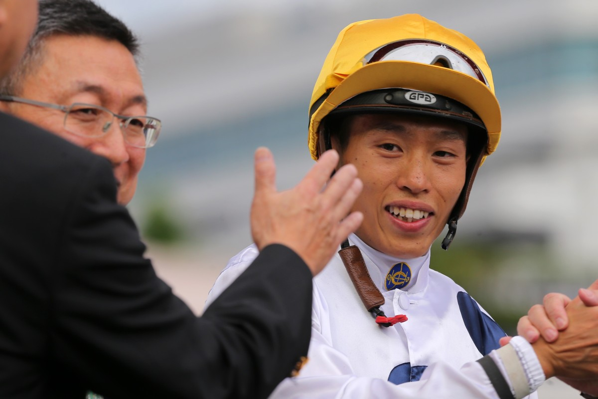 Vincent Ho celebrates a Golden Sixty win with trainer Francis Lui. Photos: Kenneth Chan