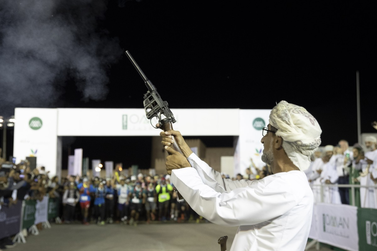 The starter fires the gun for the 2019 Oman by UTMB race. Photo: Lloyd Images/Mark Lloyd