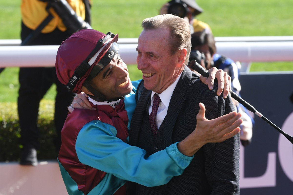 John Size and Joao Moreira embrace after Beat The Clock's win. Photos: Kenneth Chan