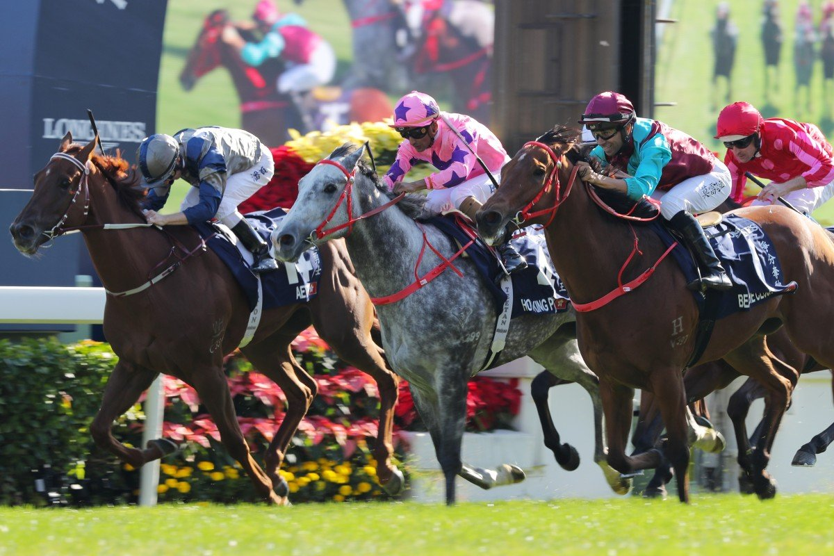 Aethero (inside) is overhauled by Hot King Prawn (middle) and Beat The Clock (outside) at Sha Tin on Sunday. Photos: Kenneth Chan