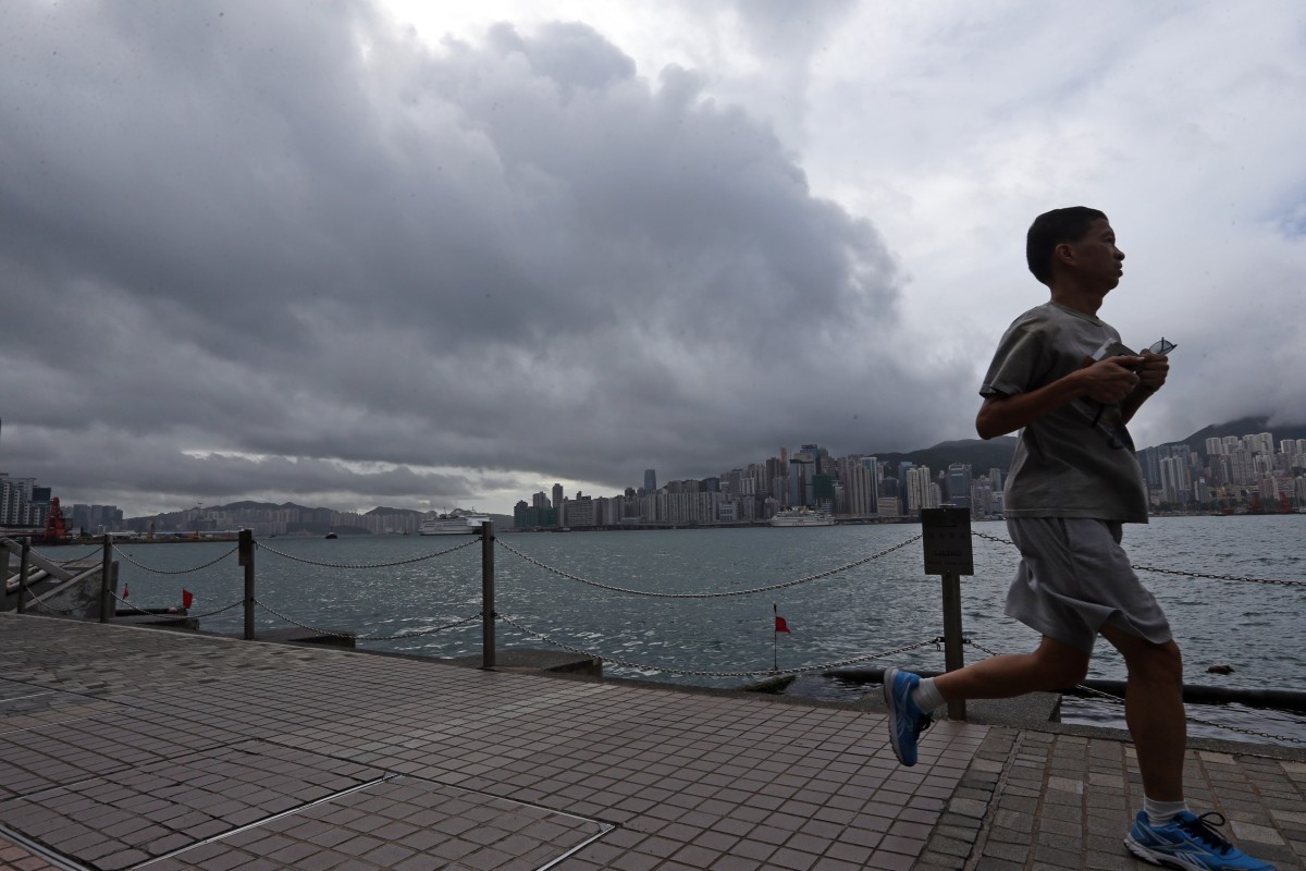 Running along Tsim Sha Tsui as Standby Signal No. 1 us raised by the Hong Kong Observatory in 2016 – Hong Kong needs to protect the coastal running routes from typhoons. Photo: Felix Wong