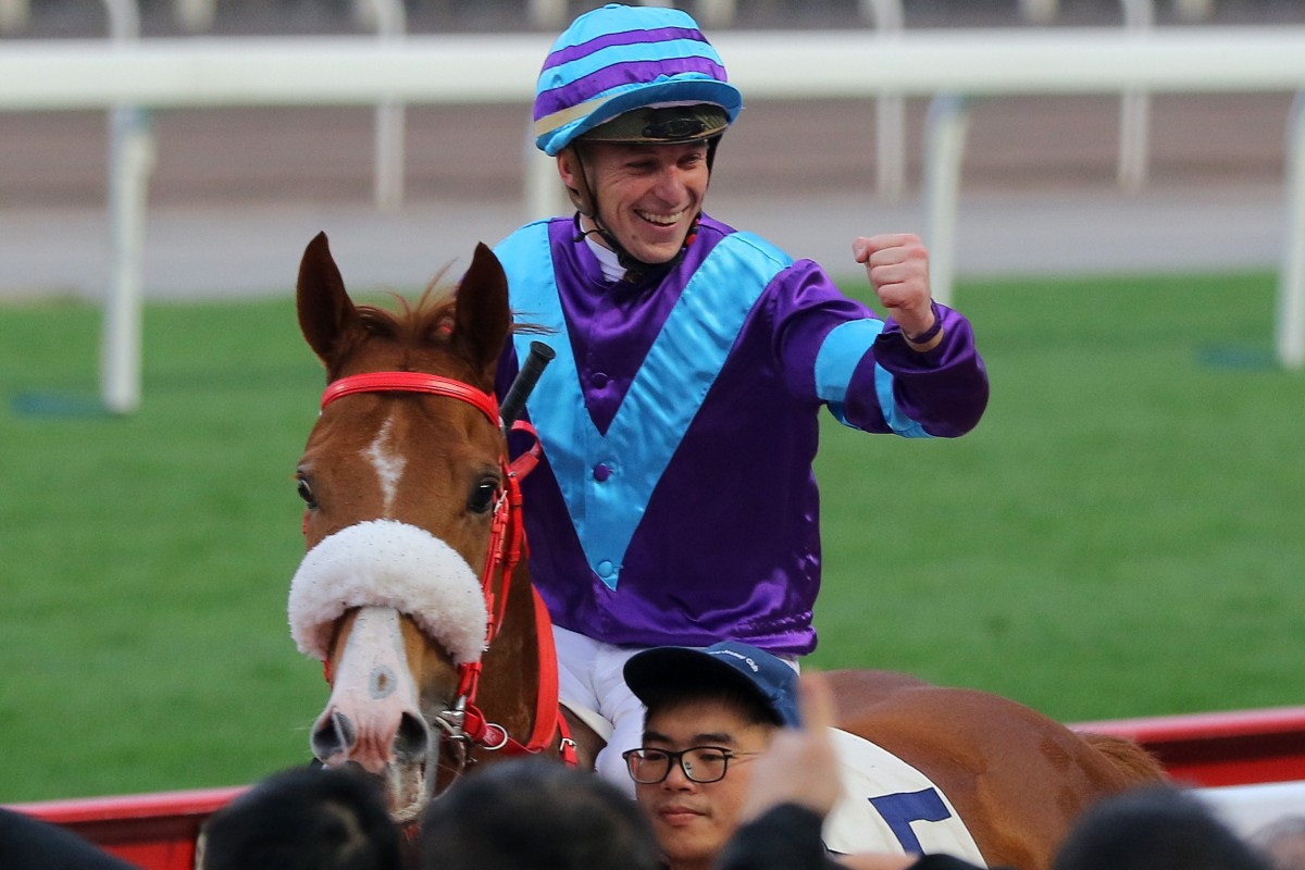 Tonny Piccone pumps his fist after winning aboard Charity Go. Photos: Kenneth Chan