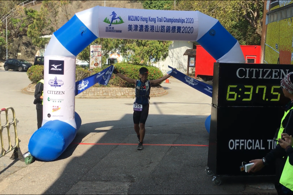 Tsang Fuk-cheung crosses the finish line of the Hong Kong Trail Championships, his third race in just seven days. Photo: Mark Agnew