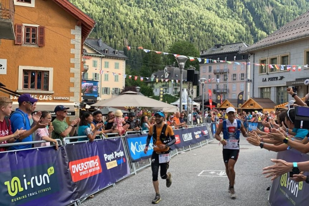 Wong Ho-chung and Joaquin Lopez cross the finish line of the UTMB 2019 in joint sixth. Photo: Ryan Blair