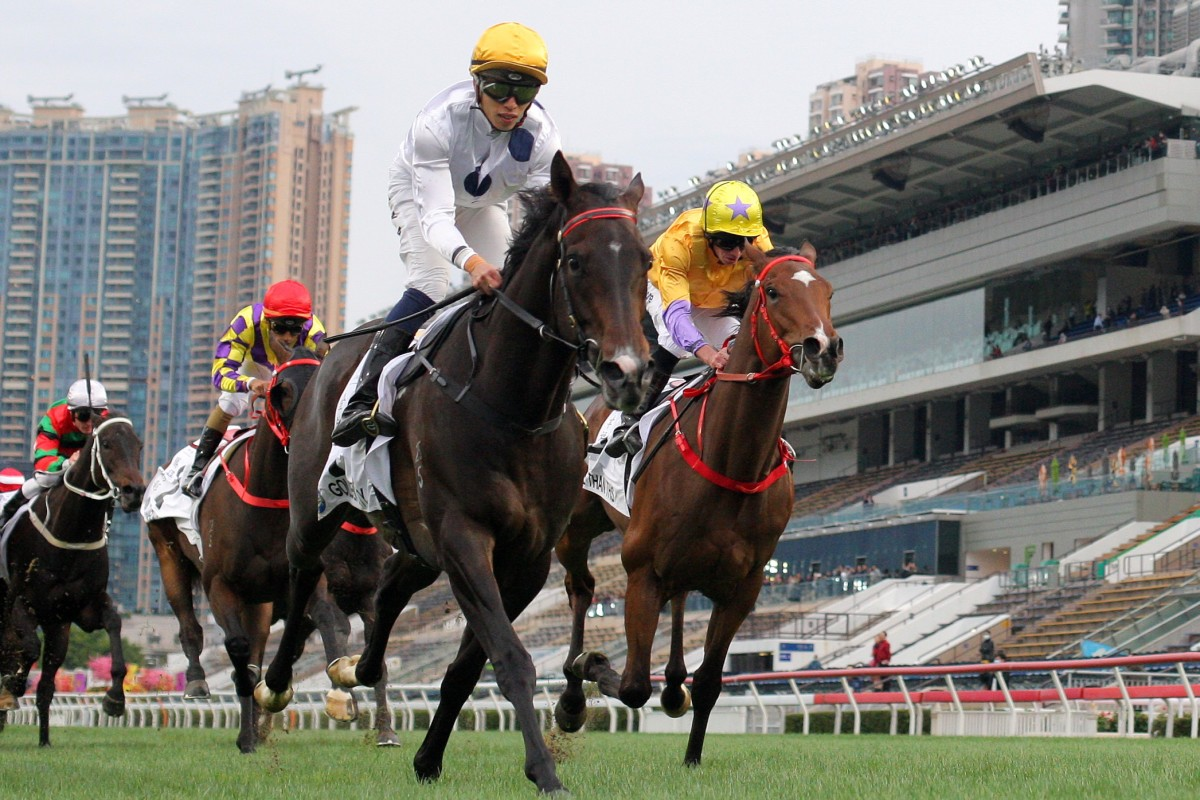 Golden Sixty surges home to win ahead of stablemate More Than This at Sha Tin on Monday. Photos: Kenneth Chan
