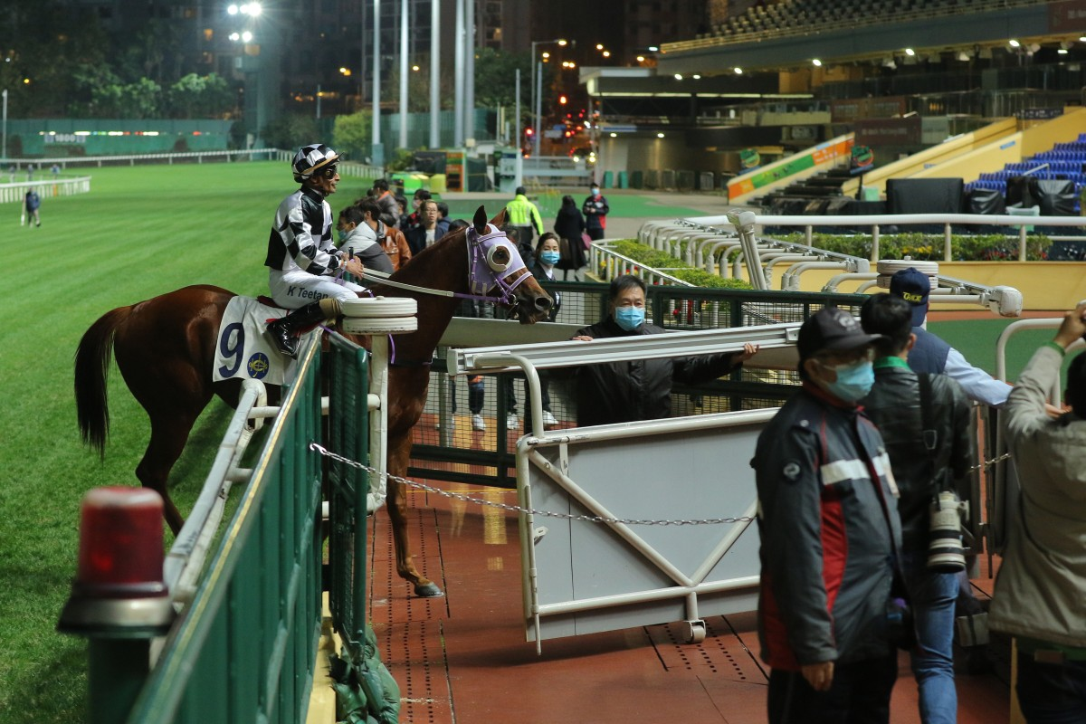 Karis Teetan returns to scale after winning aboard Master Albert in front of empty stands at Happy Valley on Wednesday night. Photos: Kenneth Chan