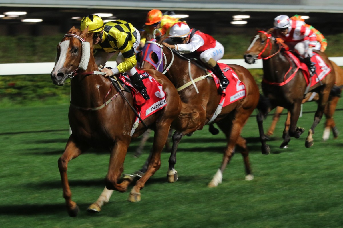 Zac Purton guides Stronger to victory at Happy Valley on Wednesday night. Photos: Kenneth Chan