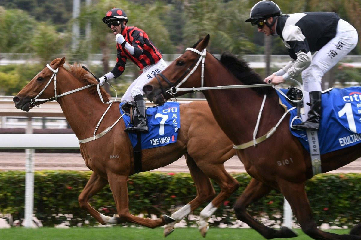 Exultant (right) is beaten home by Time Warp at Sha Tin on Sunday. Photos: Kenneth Chan