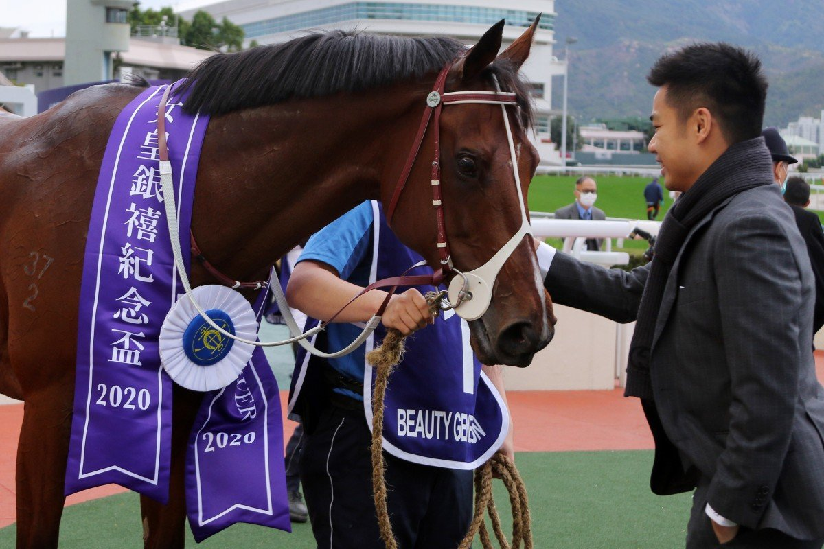 Beauty Generation's owner Patrick Kwok pats his horse after winning. Photos: Kenneth Chan