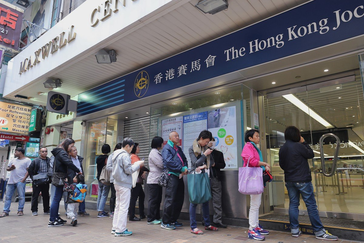 Punters line up to place bets at a Jockey Club betting branch. Photo: Winson Wong