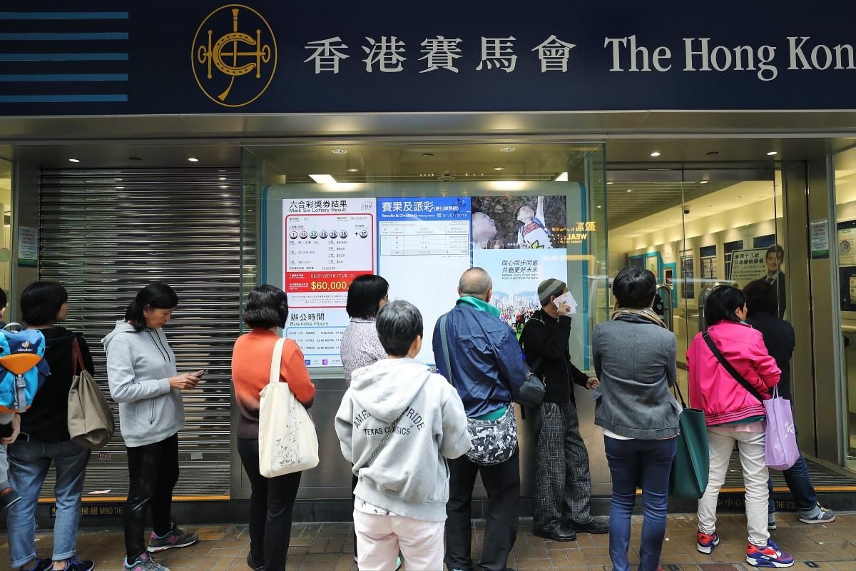 Punters line up at a Hong Kong Jockey Club off-course betting branch. Photo: SCMP / Winson Wong