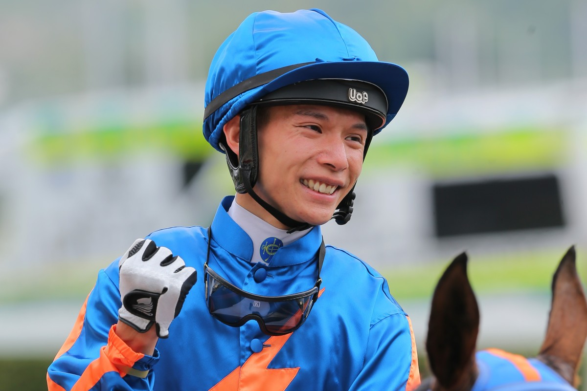 Victor Wong celebrates his breakthrough win aboard Smiling Success. Photos: Kenneth Chan