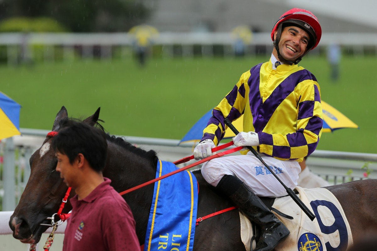 Joao Moreira is all smiles after saluting aboard Champion's Way last season. Photos: Kenneth Chan