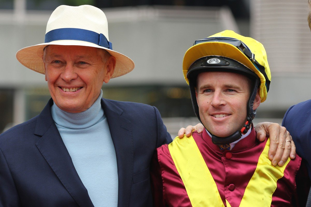 Trainer John Moore with jockey Tommy Berry. Photos: Kenneth Chan