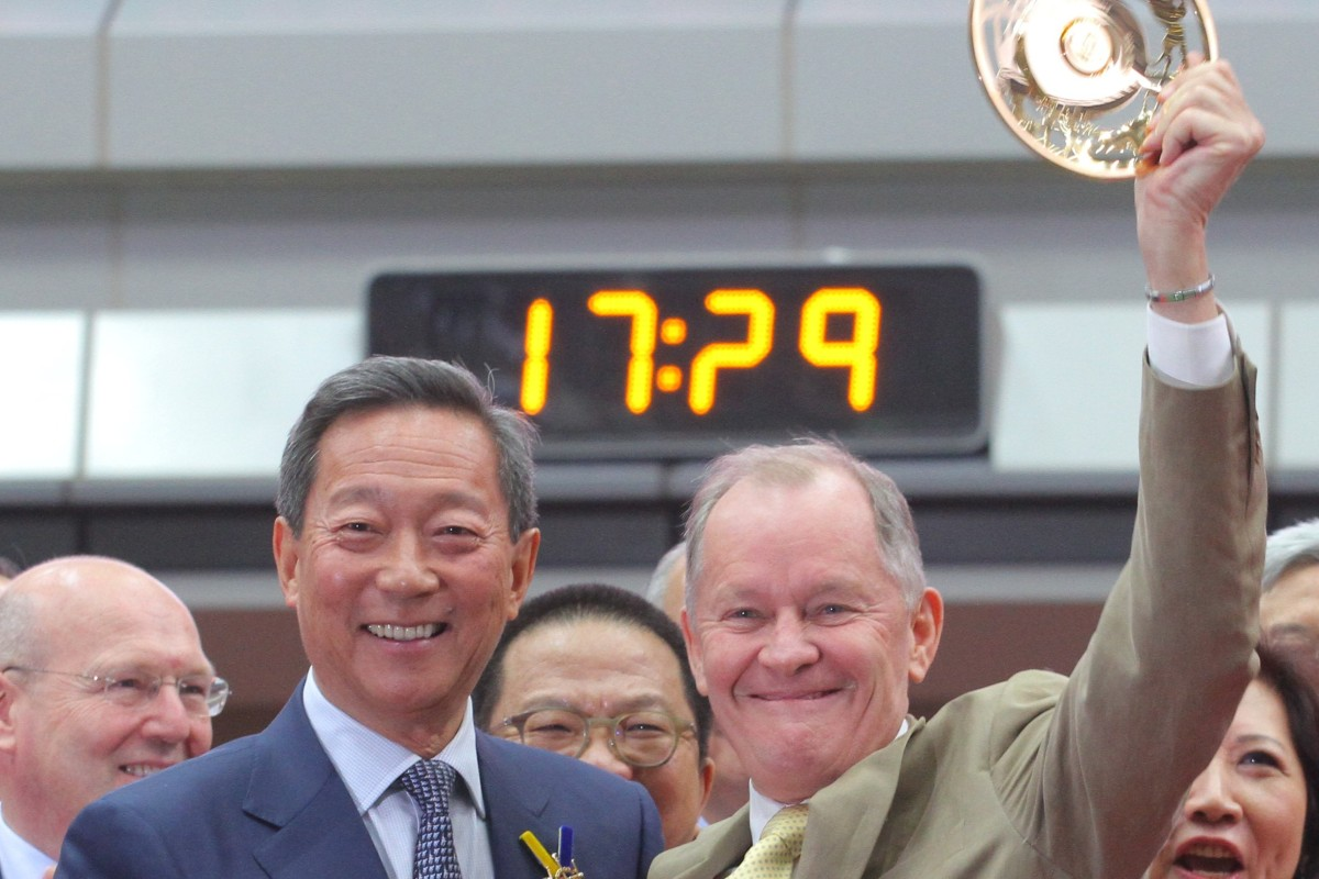Former Jockey Club chairman Simon Ip presents trainer John Moore with the 2016 Hong Kong Derby spoils after his victory with Werther. Photos: Kenneth Chan