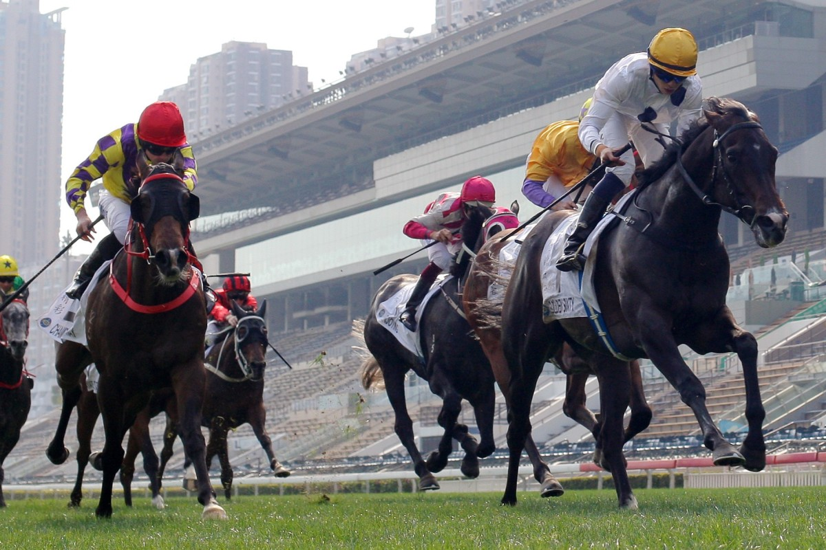 Vincent Ho guides Golden Sixty to victory in the Classic Cup in front of the empty stands at Sha Tin. Photos: Kenneth Chan