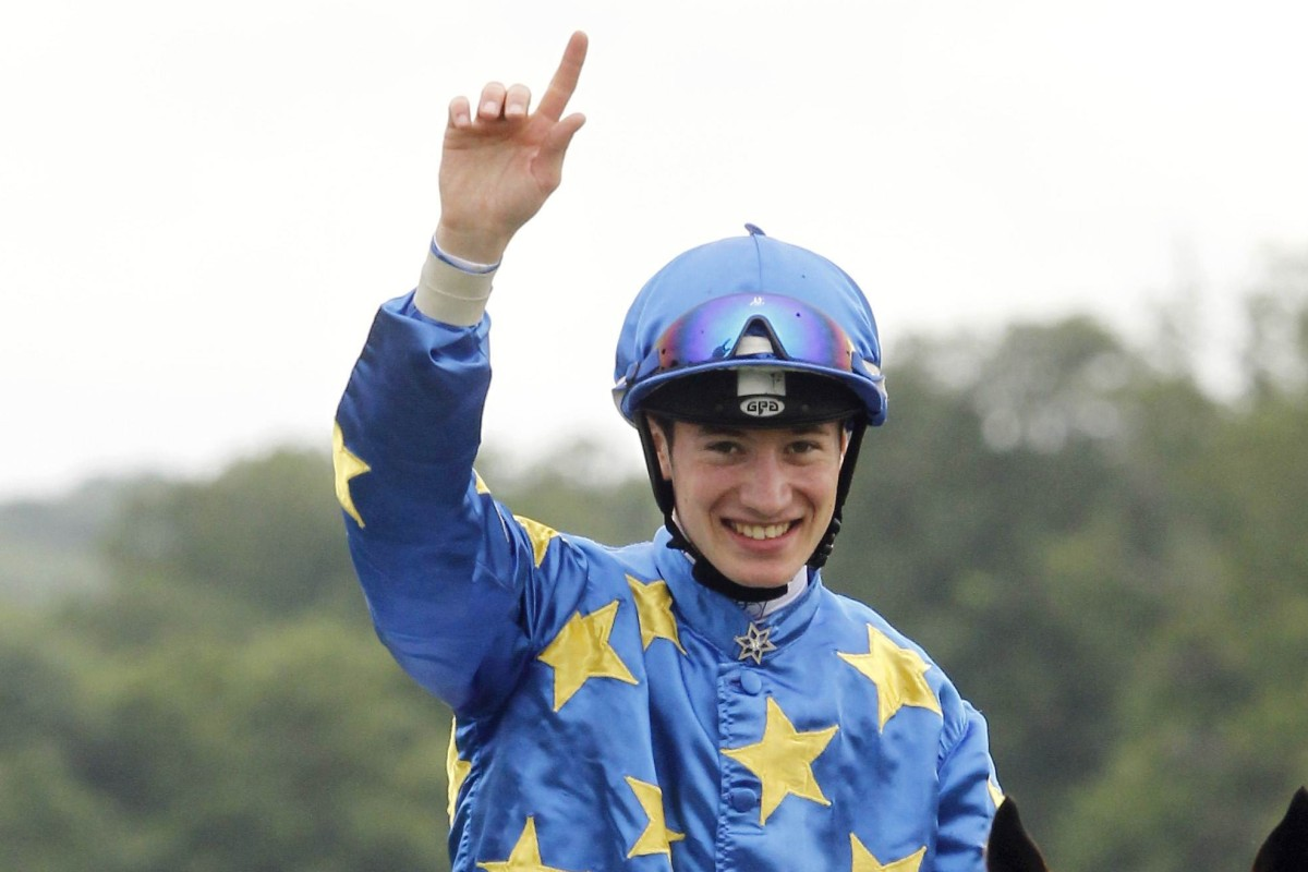 French jockey Antoine Hamelin celebrates after winning the Group One Prix du Jockey Club with Saonois. Photo: AFP