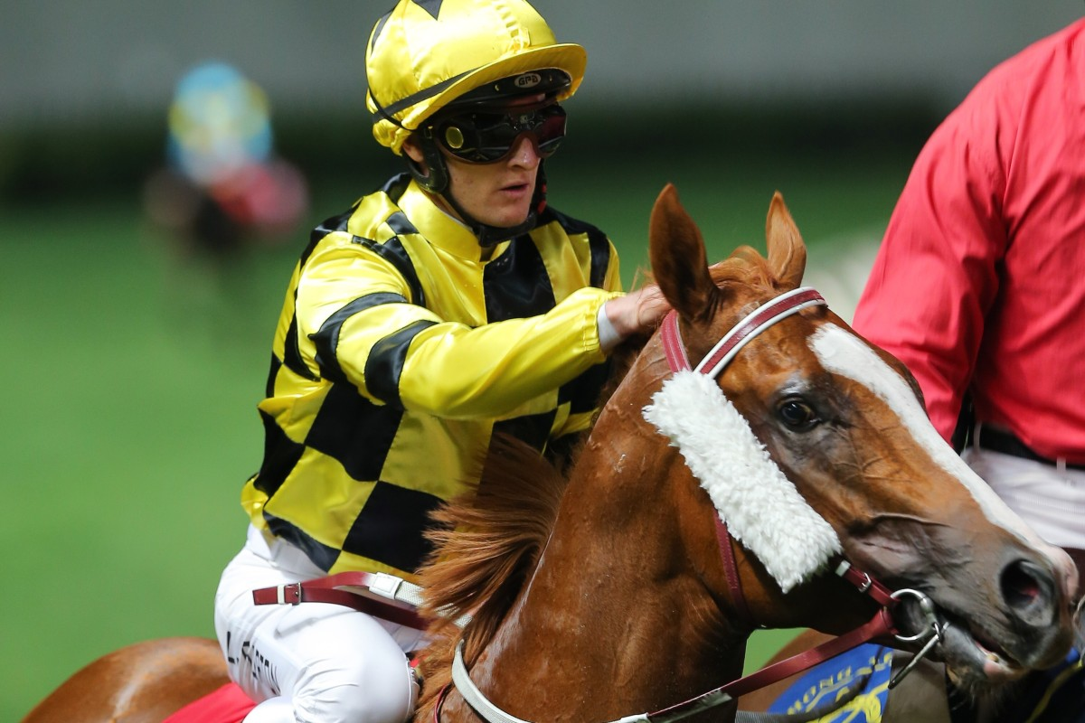Zac Purton gives Stronger a pat after his track record in February. Photos: Kenneth Chan