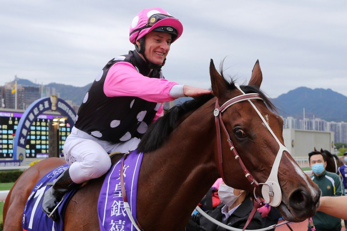 Zac Purton gives Beauty Generation a pat after winning the Queen's Silver Jubilee Cup in February. Photos: Kenneth Chan