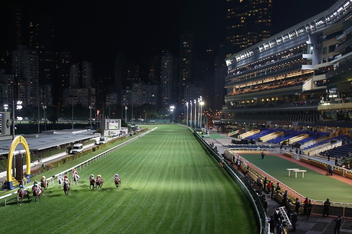 Horses cross the line at an empty Happy Valley. Photos: Kenneth Chan