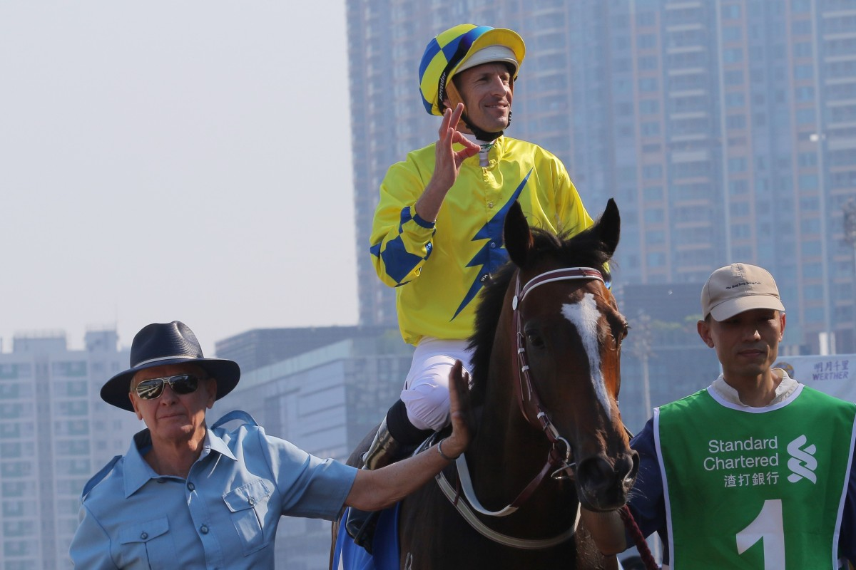 John Moore returns with jockey Hugh Bowman after winning the Champions & Chater Cup with Werther in 2017.