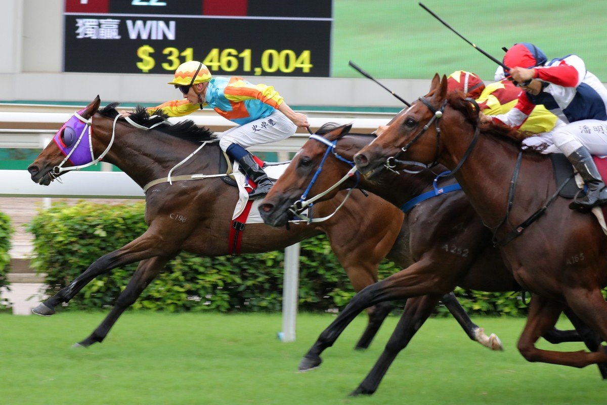 Chad Schofield drives Ka Ying Star to victory in Sunday's Group Three Lion Rock Trophy at Sha Tin. Photos: Kenneth Chan