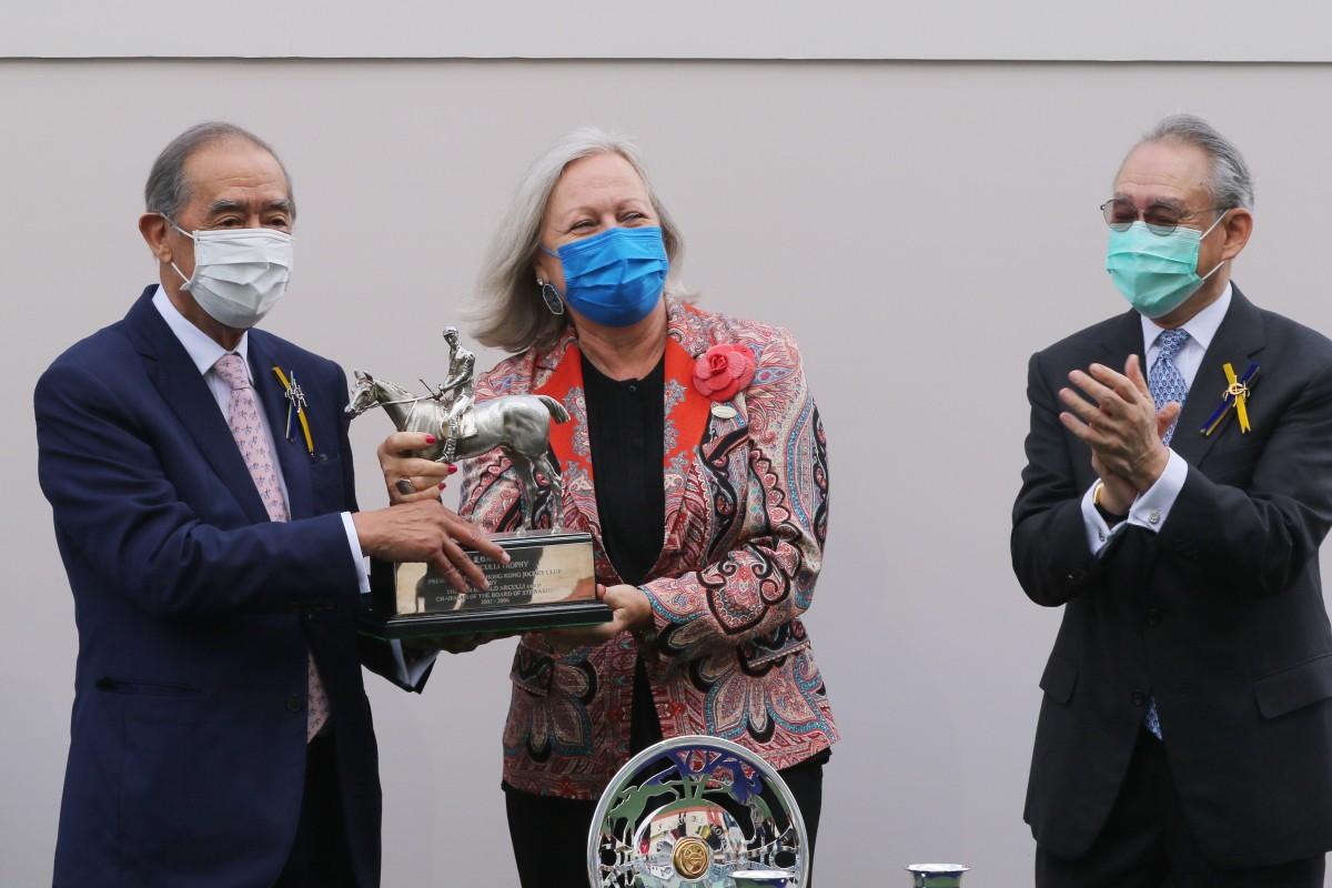 Ronald Arculli accepts the spoils for the Arculli Trophy from wife Johanna at Sha Tin on Sunday. Photos: Kenneth Chan