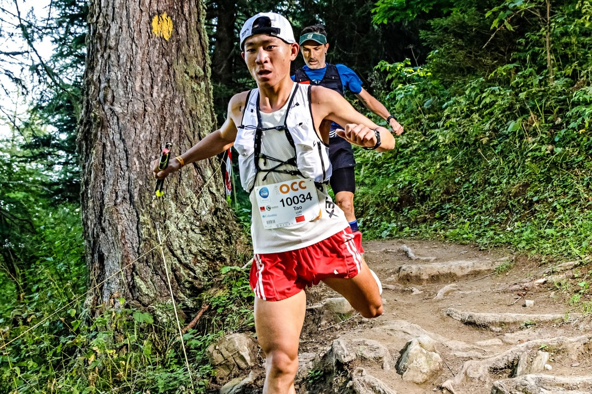 Luo Tao flies downhill at the OCC, during the Ultra Trail du Mont Blanc week. Photo: UTMB