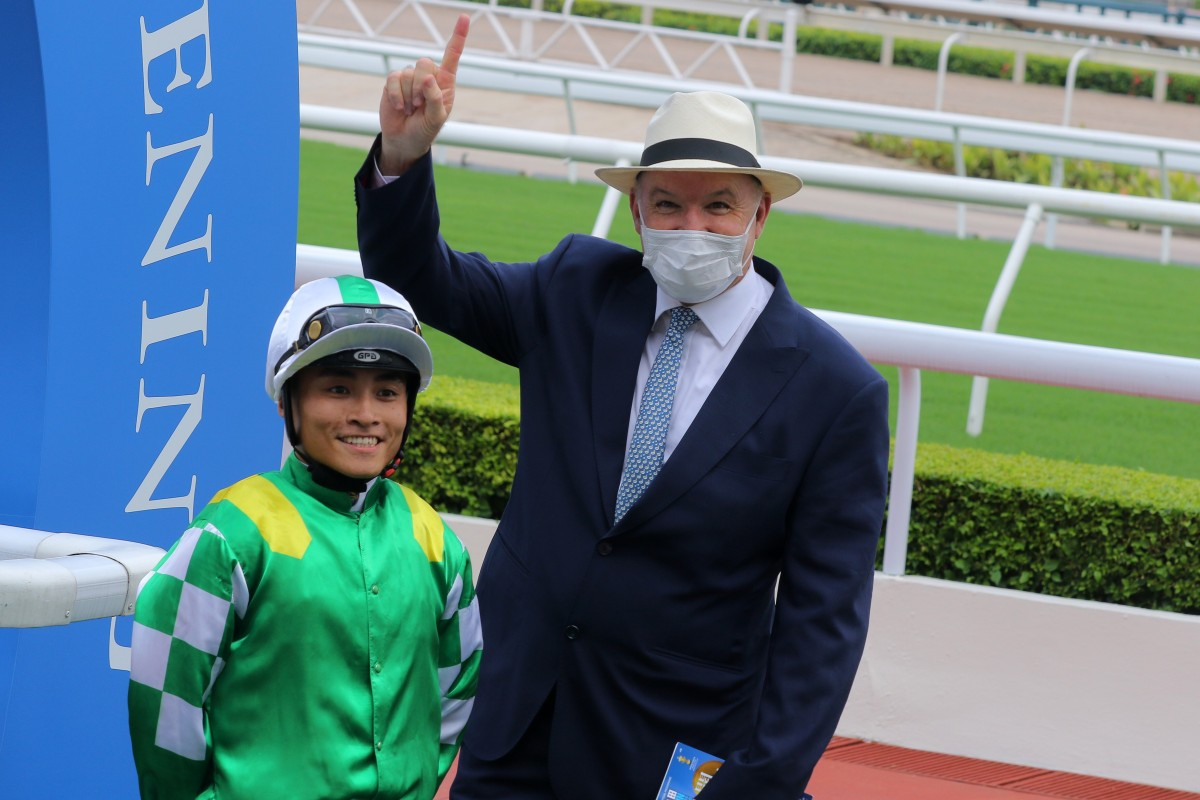 Trainer David Hayes and jockey Keith Yeung celebrate Moneymore's win at Sha Tin on Sunday. Photos: Kenneth Chan