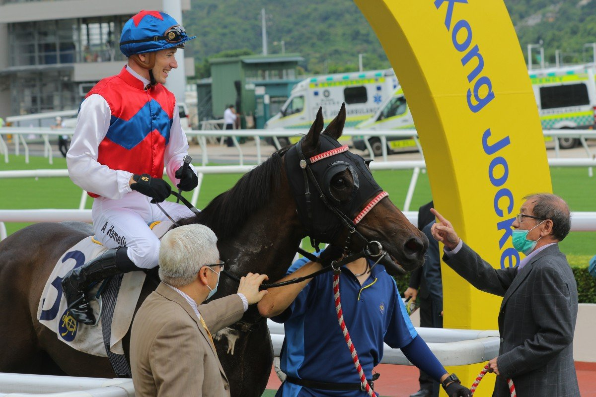 Winwin Thirtythree's owner give the horse a pat after winning at Sha Tin on Sunday. Photos: Kenneth Chan