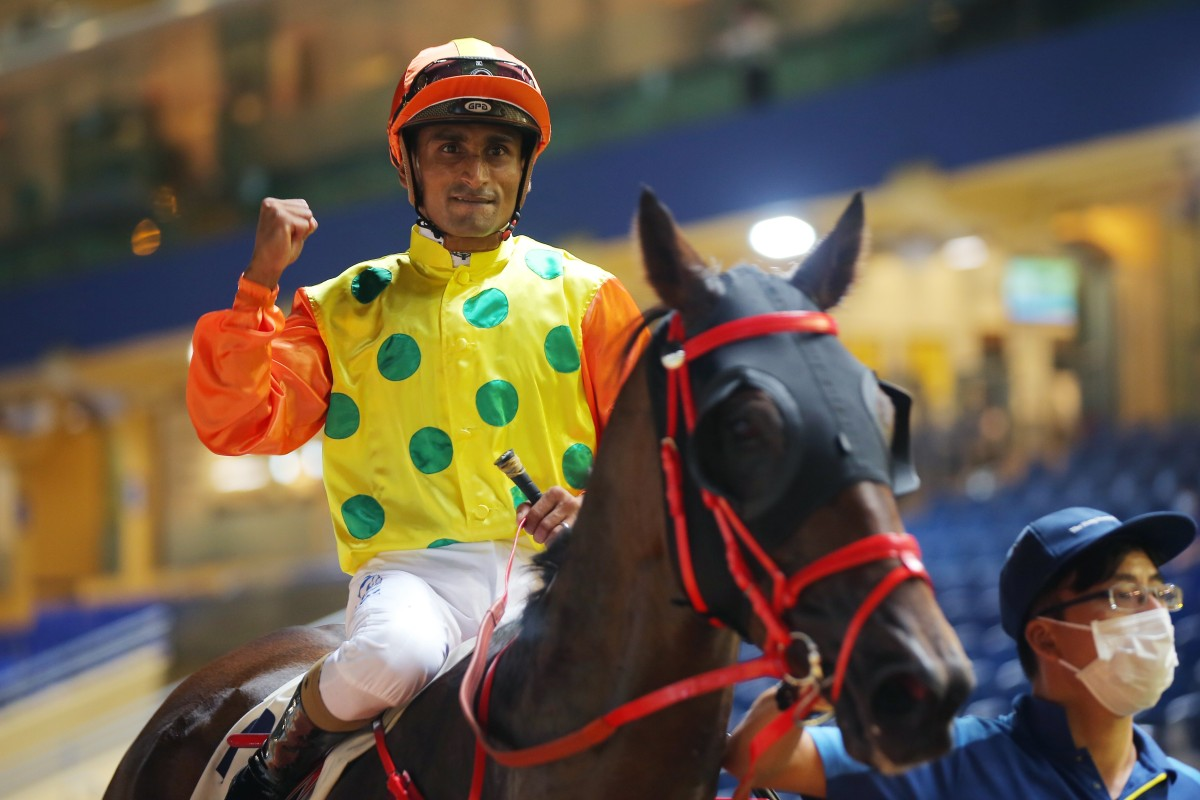 Karis Teetan pumps his fist after winning aboard Supreme Plus at Happy Valley on Wednesday night. Photos: Kenneth Chan