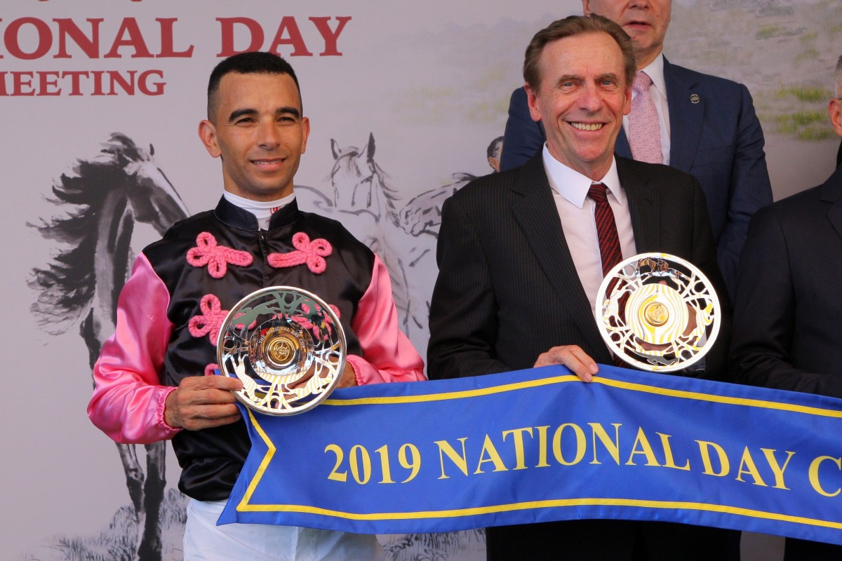 Joao Moreira and John Size pose for photos with their trophies after winning the 2019 National Day Cup with Full Of Beauty. Photos: Kenneth Chan