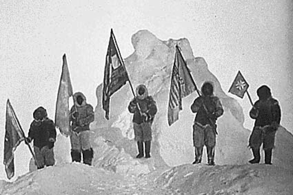 Matthew Henson (centre), holding the polar flag, and his Inuit colleagues at the North Pole. But it was Henson's long-time friend Robert Peary who was recognised for the expedition. Photo: Public Domain