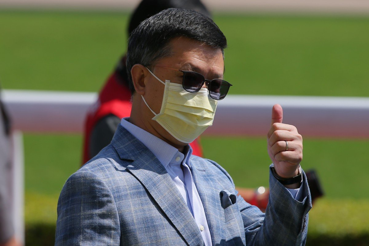 Peter Ho gives the thumbs up after Amazing Agility's win on Sunday. Photo: Kenneth Chan