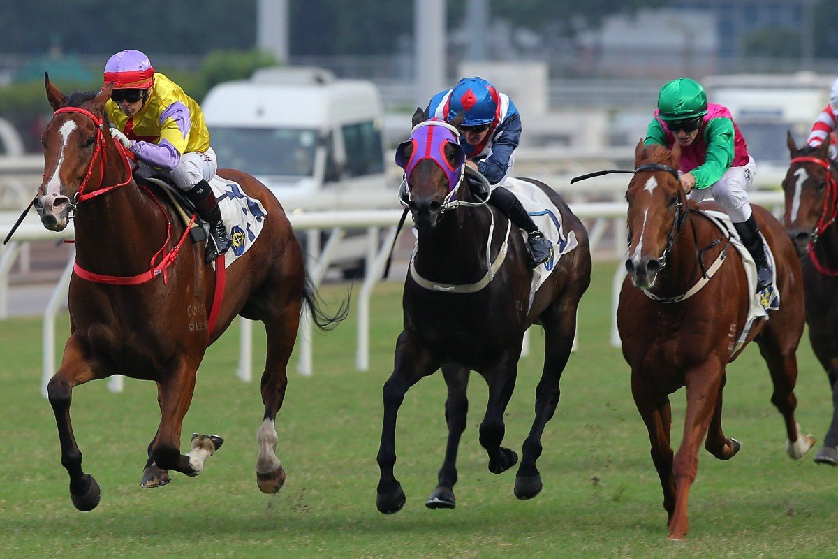Jockey Alexis Badel and Ping Hai Bravo (left) storm past Flying Genius (middle) and Joyful Fortune (right). Photo: Kenneth Chan