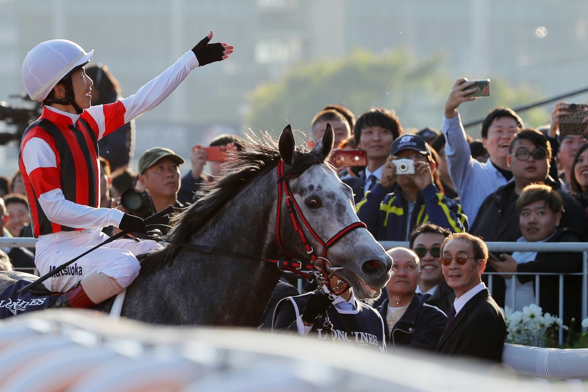 Jockey Masami Matsuoka celebrates with fans after winning the 2019 Hong Kong Cup aboard Win Bright. Photo: Kenneth Chan