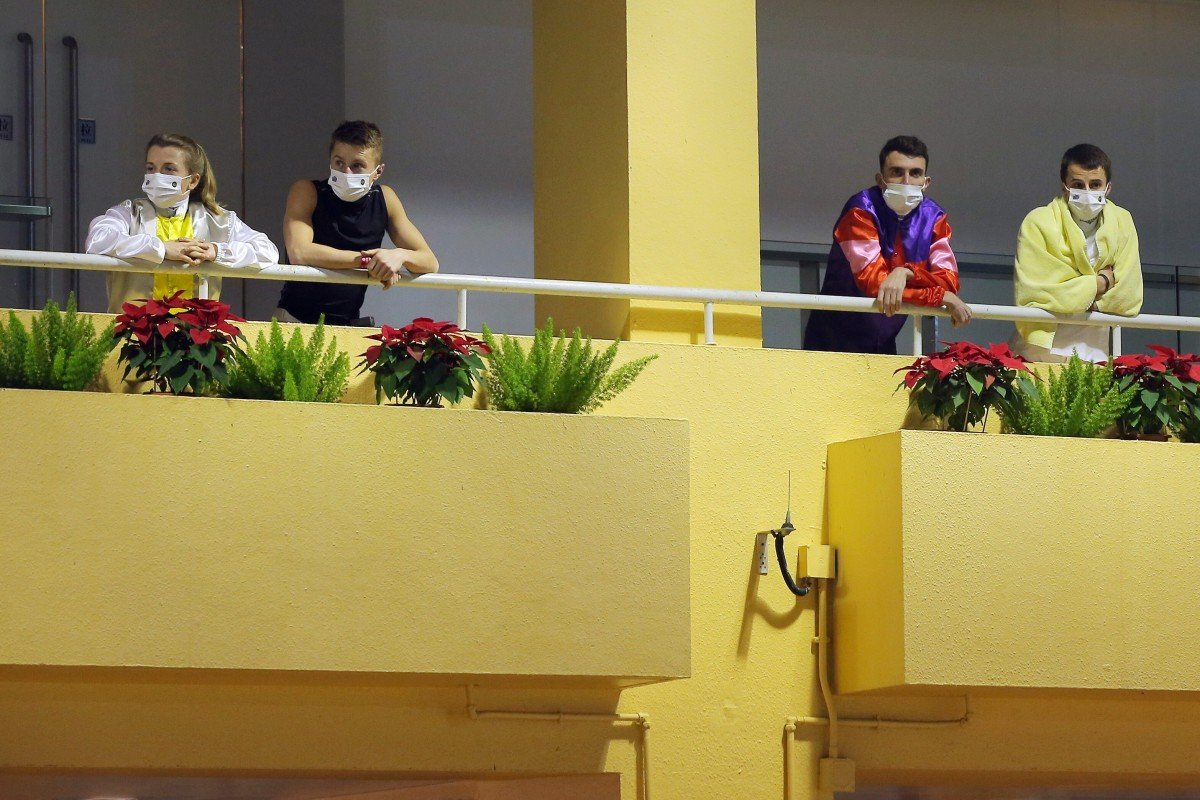 The visiting jockeys look out over Happy Valley from their separate rooms on Wednesday night. Photo: Kenneth Chan