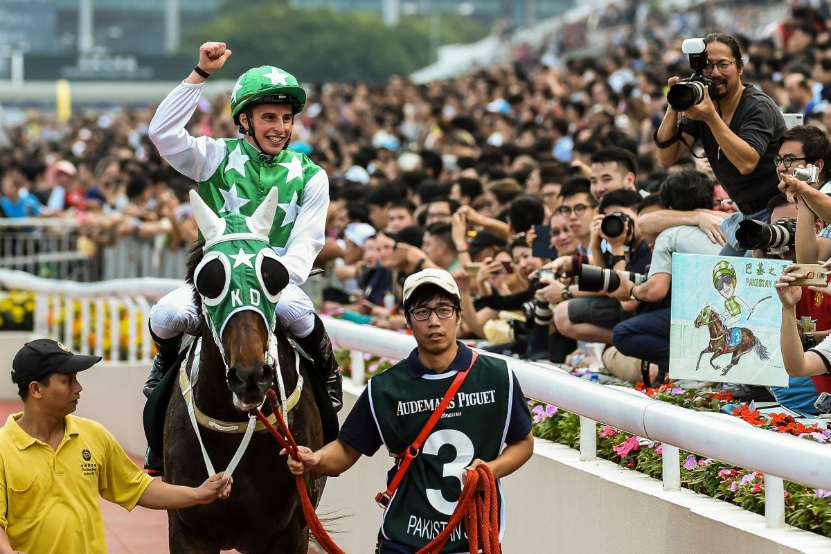 William Buick relishes Pakistan Star's win in the Group One QE II Cup at Sha Tin in 2018. Photo: AFP
