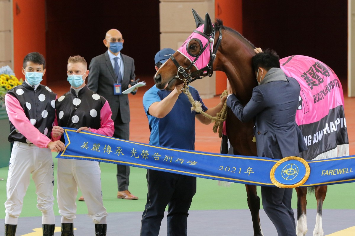 Owner Patrick Kwok gives Beauty Generation a hug at Sha Tin on Sunday. Photos: Kenneth Chan