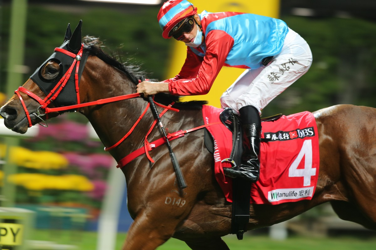 Christophe Soumillon crosses the line a winner at Happy Valley on Wednesday night. Photos: Kenneth Chan