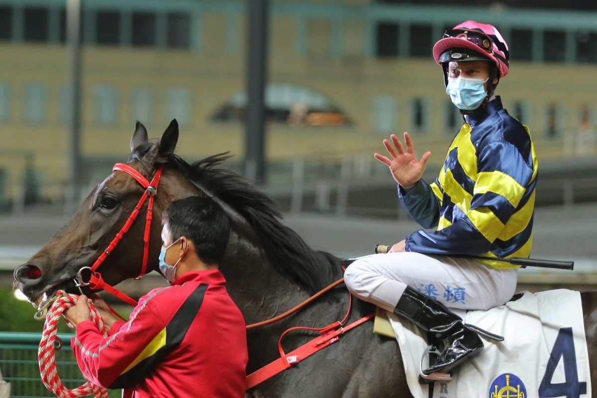 Zac Purton acknowledges his five winners after returning to scale aboard Wind N Grass. Photo: Kenneth Chan