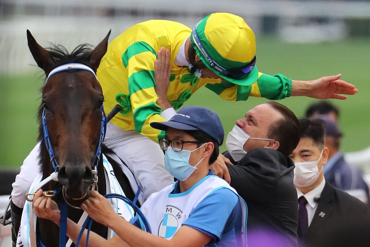 Caspar Fownes and Joao Moreira embrace after winning the BMW Hong Kong Derby with Sky Darci. Photos: Kenneth Chan