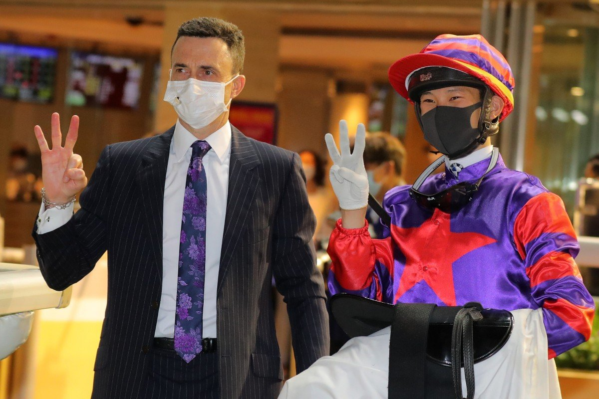 Douglas Whyte and Jerry Chau celebrate their trebles at Happy Valley on Wednesday night. Photo: Kenneth Chan