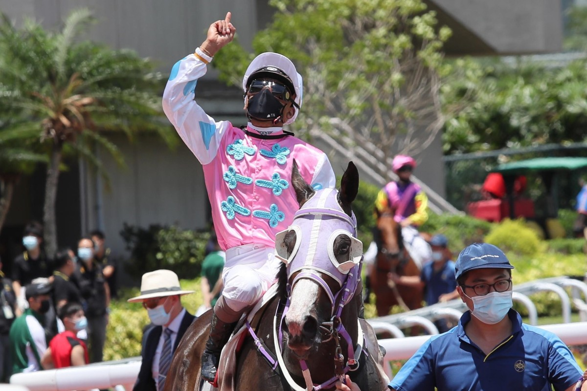 Karis Teetan pays tribute to Nooresh Juglall after riding a winner at Sha Tin on Sunday. Photo: HKJC