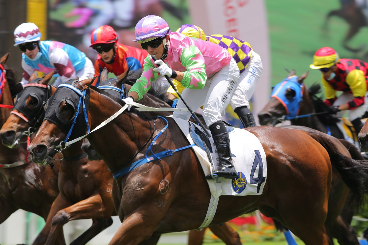 Alfred Chan salutes as Joy Master crosses the line a winner. Photos: Kenneth Chan