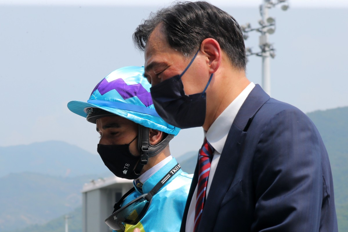 Trainer Michael Chang with jockey Joao Moreira after Steel Win's victory at Sha Tin on Sunday. Photos: Kenneth Chan