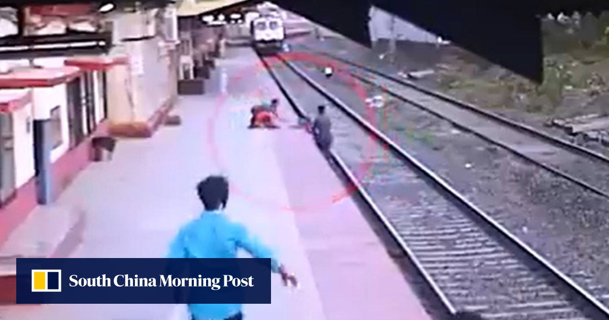 Dramatic footage shows Indian railway worker's last-gasp rescue of 6-year-old boy who fell on tracks
