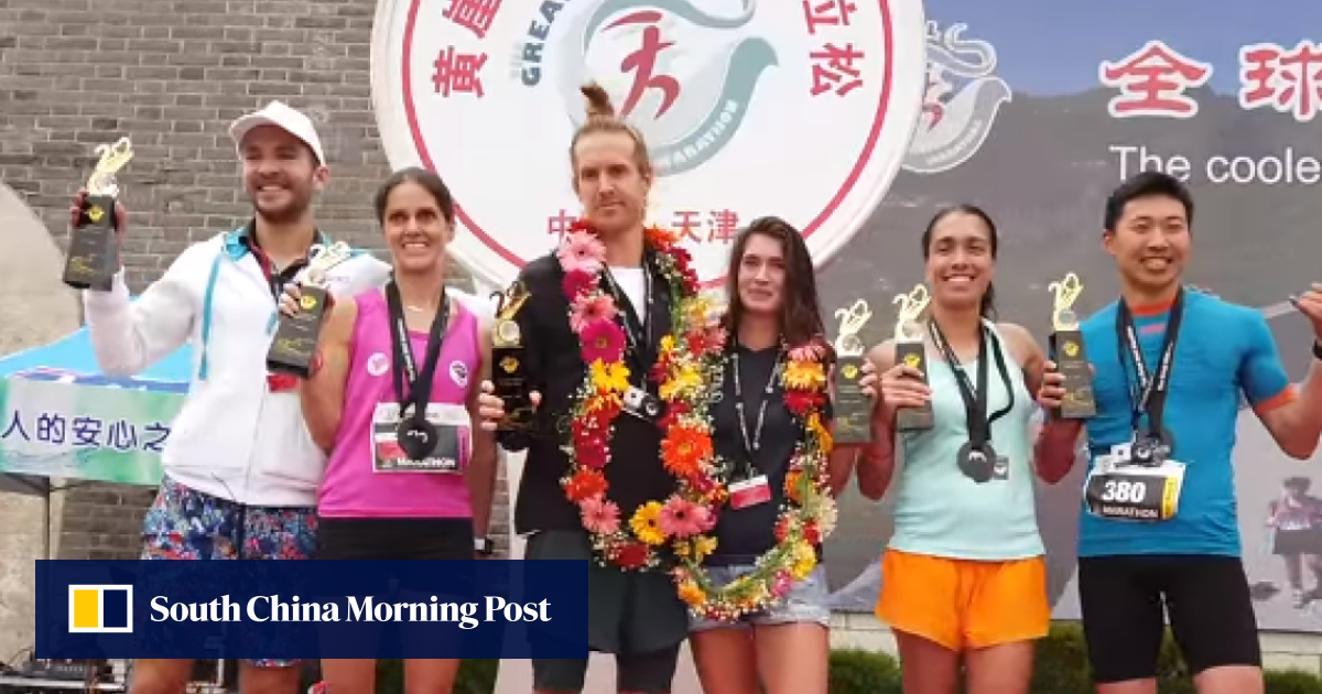 Brain cancer survivor claims Great Wall marathon win on hands and knees