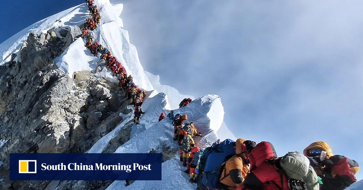 Four more Everest deaths amid traffic jam of climbers