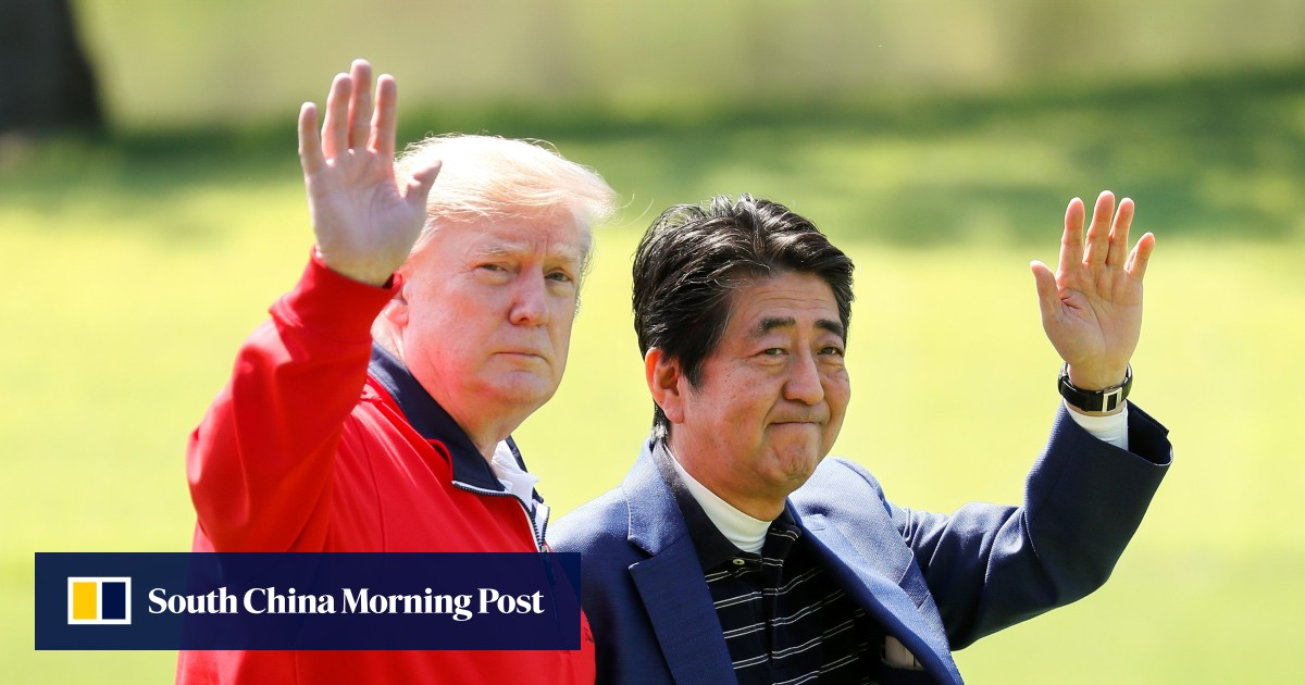 Donald Trump plays golf with Japan PM Shinzo Abe after dismissing North Korea's launch of 'some small weapons'